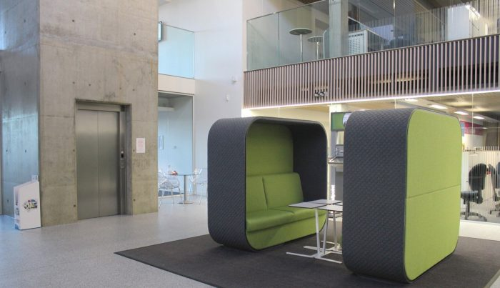 modern reception communal area with apple green accents