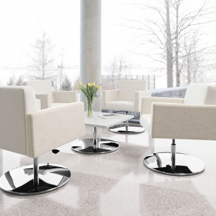 off white pedestal chairs in a lounge setting