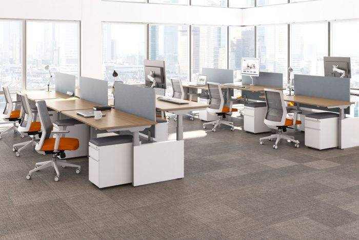 Height adjustable desks with white base and wood top