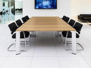 modern conference table with chrome legs and black chairs