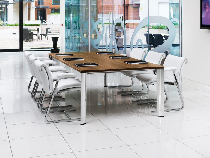 modern conference tables with chrome legs and white chairs
