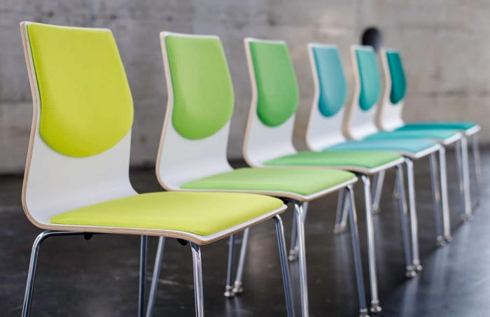 wood veneer chair of many colors in a line in greens and blues