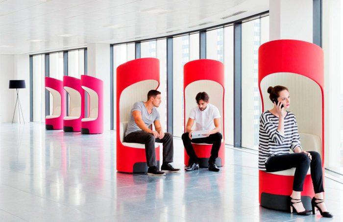 bright pink and red privacy booths in reception area