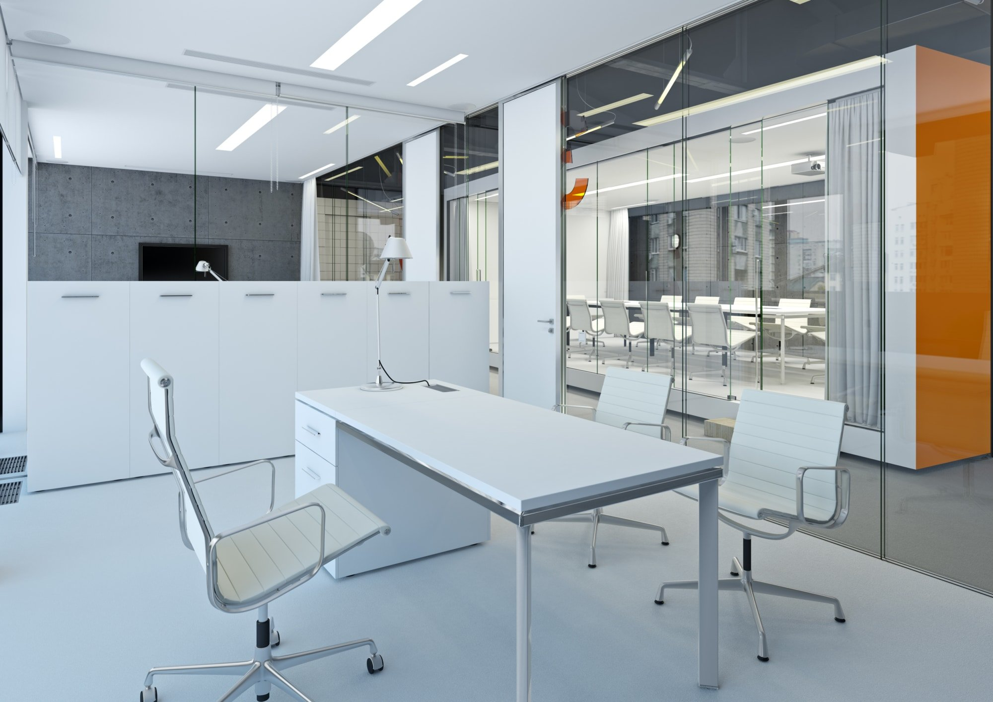 A modern white office with concrete walls