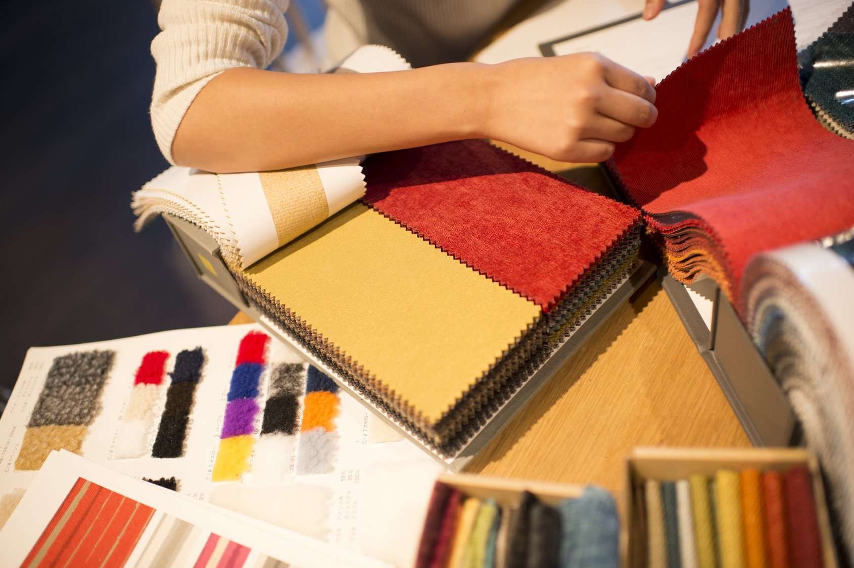 interior designer with fabric and color samples