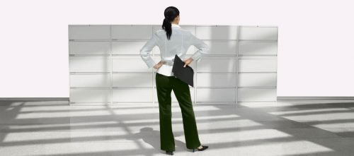 woman standing in front of Lateral Filing Systems with hand on hips