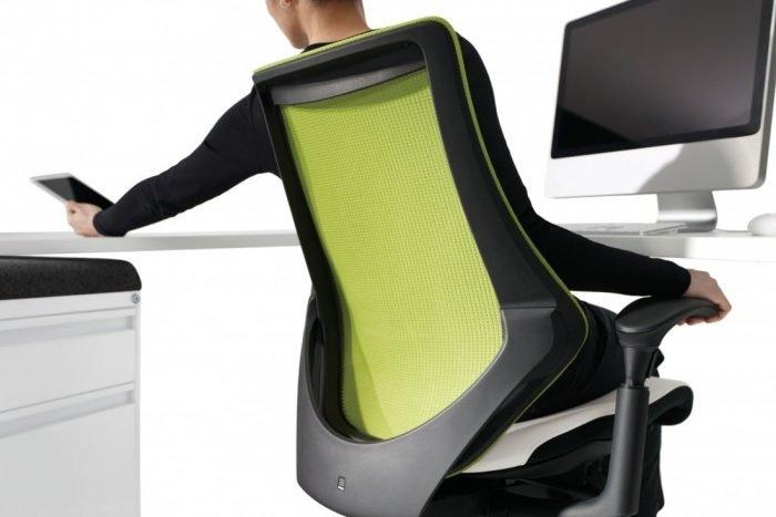 Man leaning back in green spree Ergonomic Mesh Task Chair