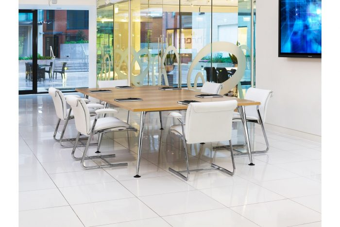 conference table with light wood top and metal legs