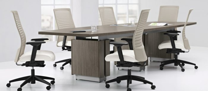 Zira Conference Boardroom Table With White Chairs In A Boardroom