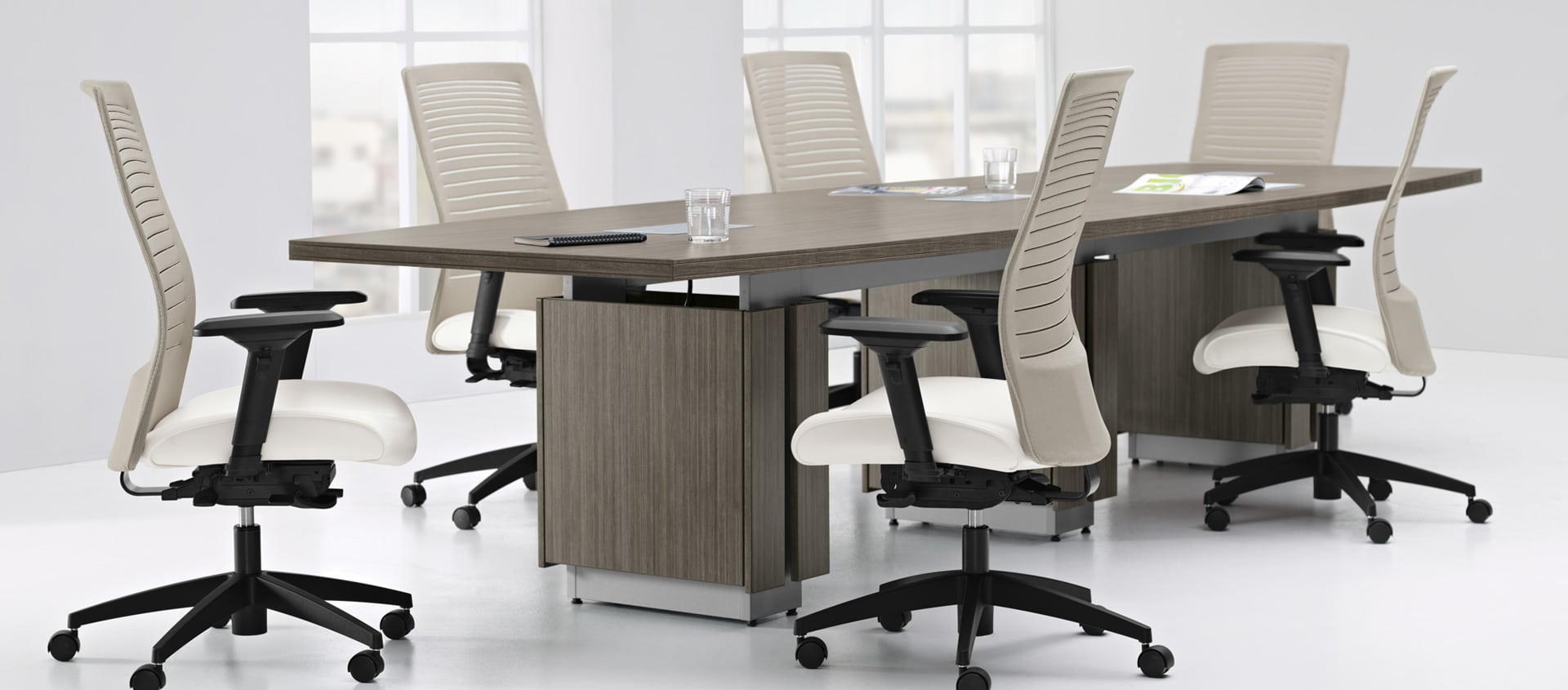 Zira Conference Boardroom Table With White Chairs In A