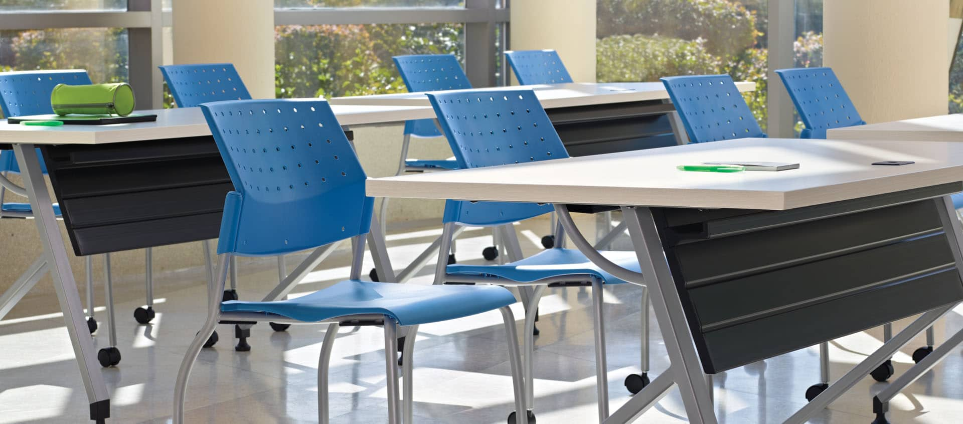 Blue Sonic Stacking Chair In Classroom Training Setting