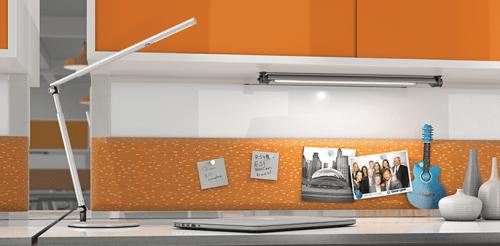 ESI Lustre LED Task Lighting On An Office Desk With Orange And White Walls