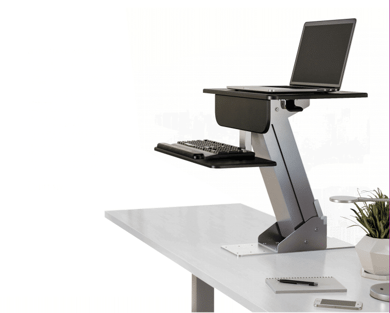 ESI Lift Sit To Stand height adjustable workstation mounted to a white desk