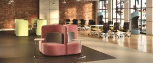 Open Concept Office Furniture In A Large Room With Brick Walls And Soft