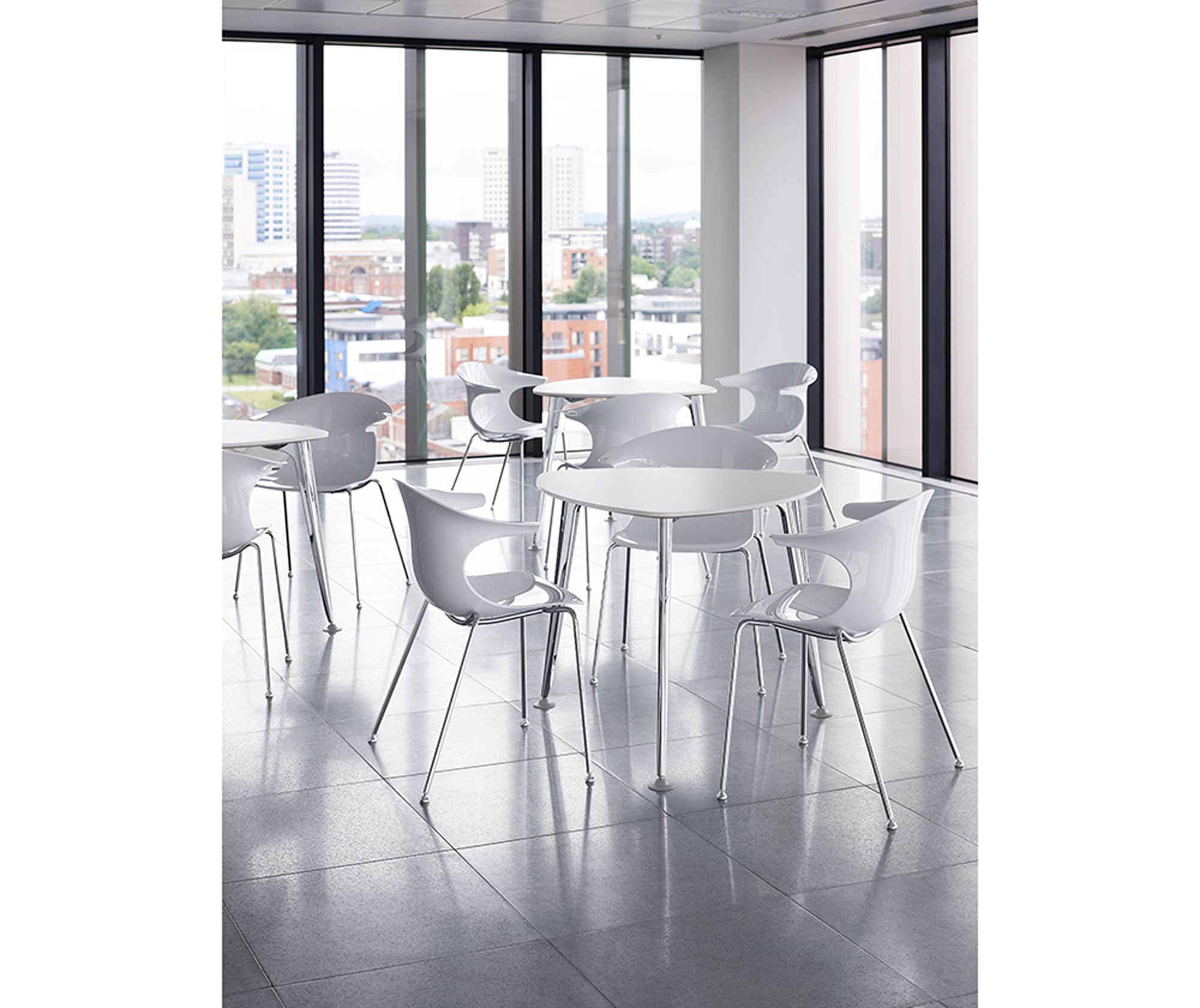 white modern cafe table and chairs