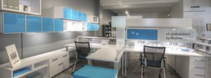 An open concept example of workplace design white workstations with bold blue accents