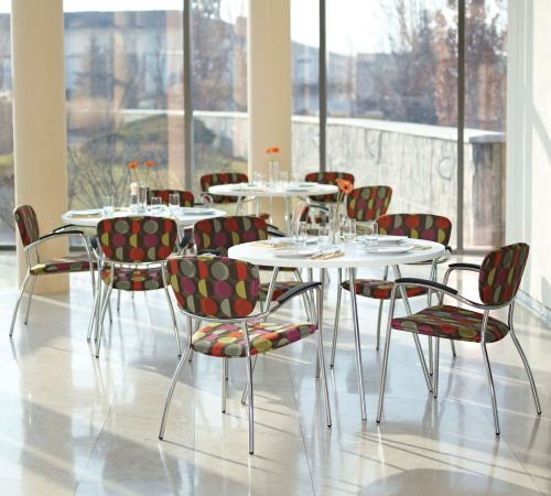 Studio photograph of patterned Caprice 3365 chairs in a cafe setup.