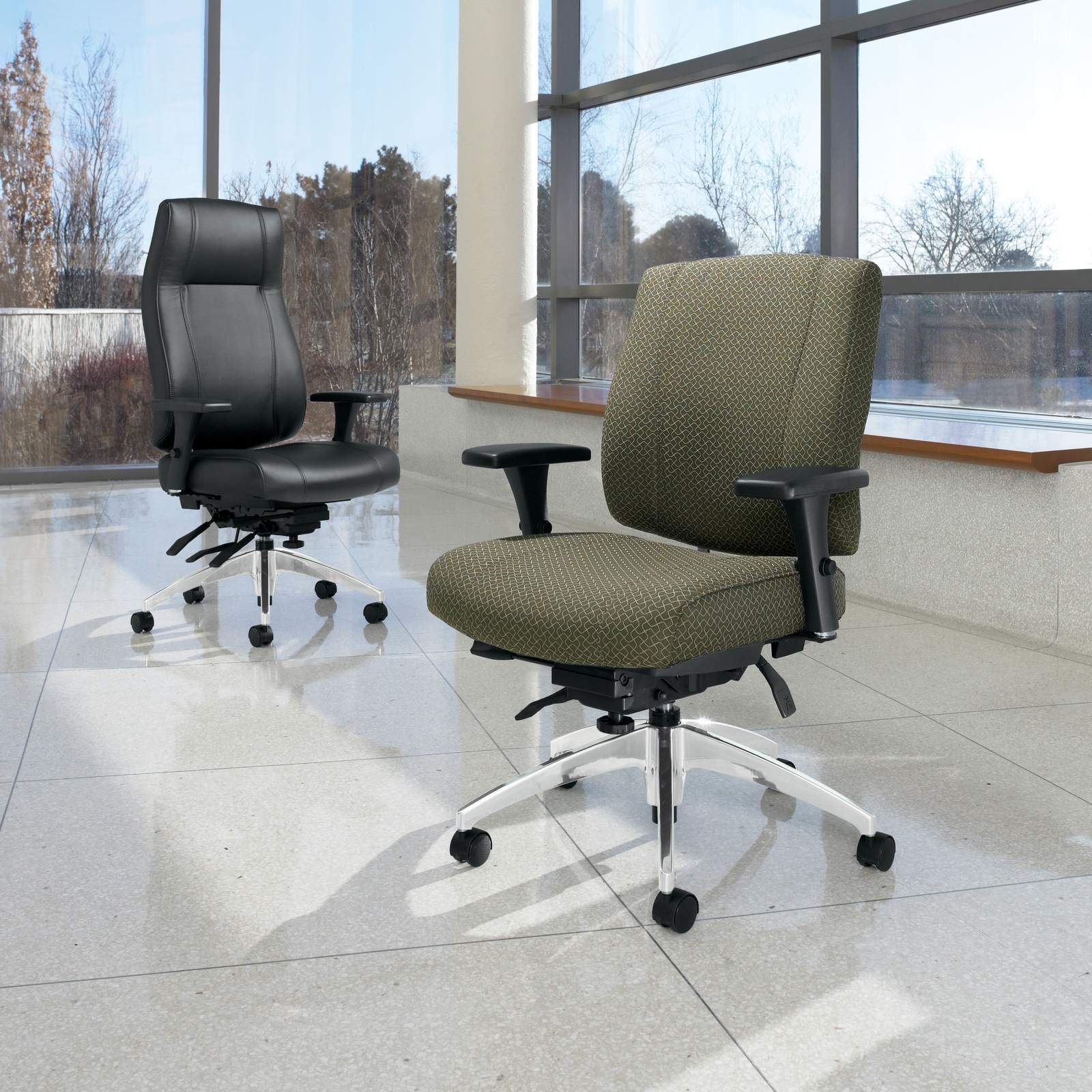 Studio photography of a high backed and medium backed Triumph rolling office chairs.