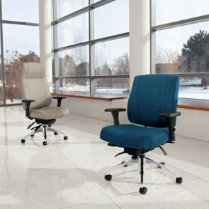 Studio photography of a high backed and medium backed Triumph rolling office chairs. One chair uses a marine blue cushion and the high backed chair uses cream colored upholstery.