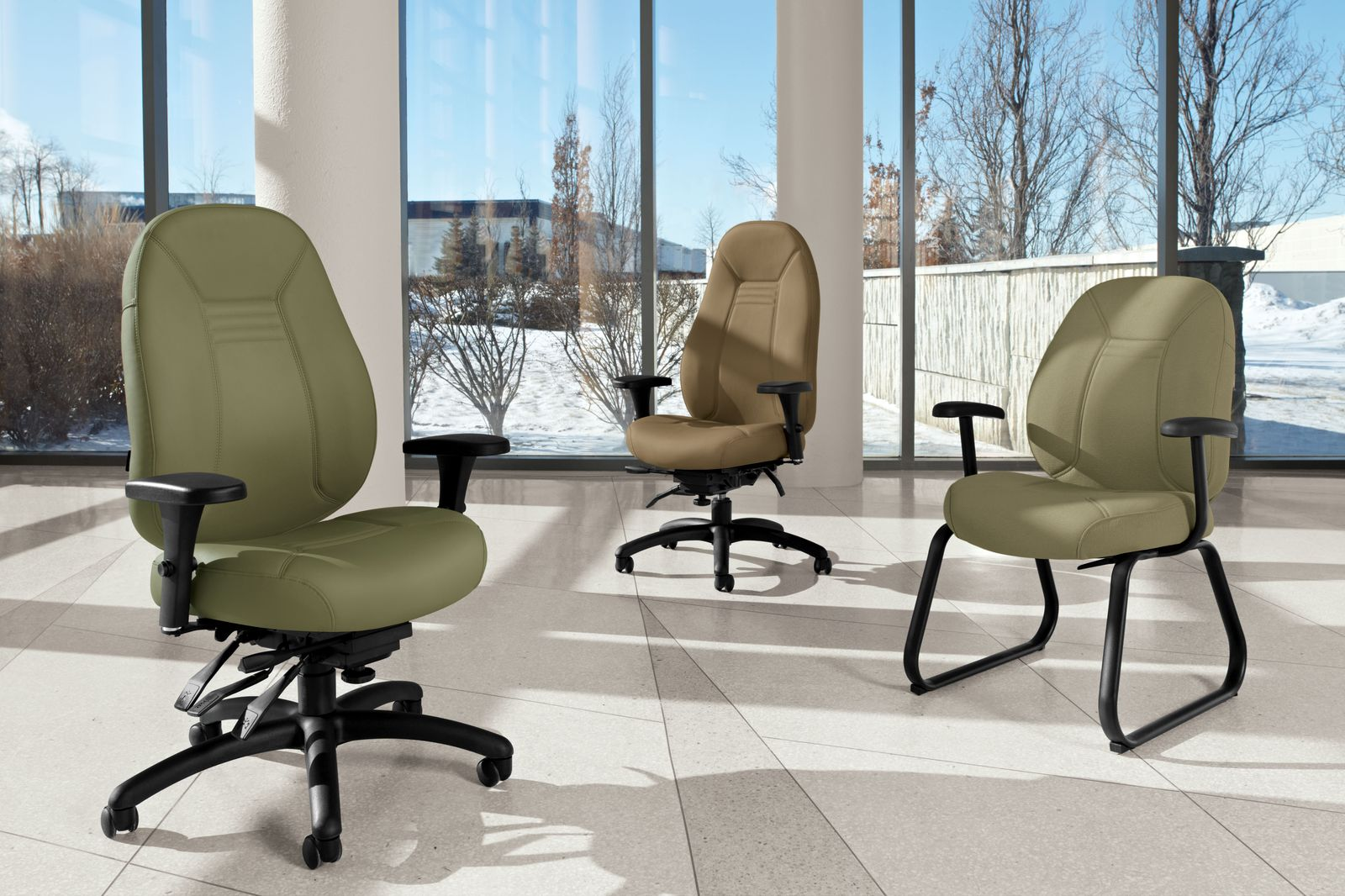 Studio shot of three Obusforme Comfort arranged in a large office space.