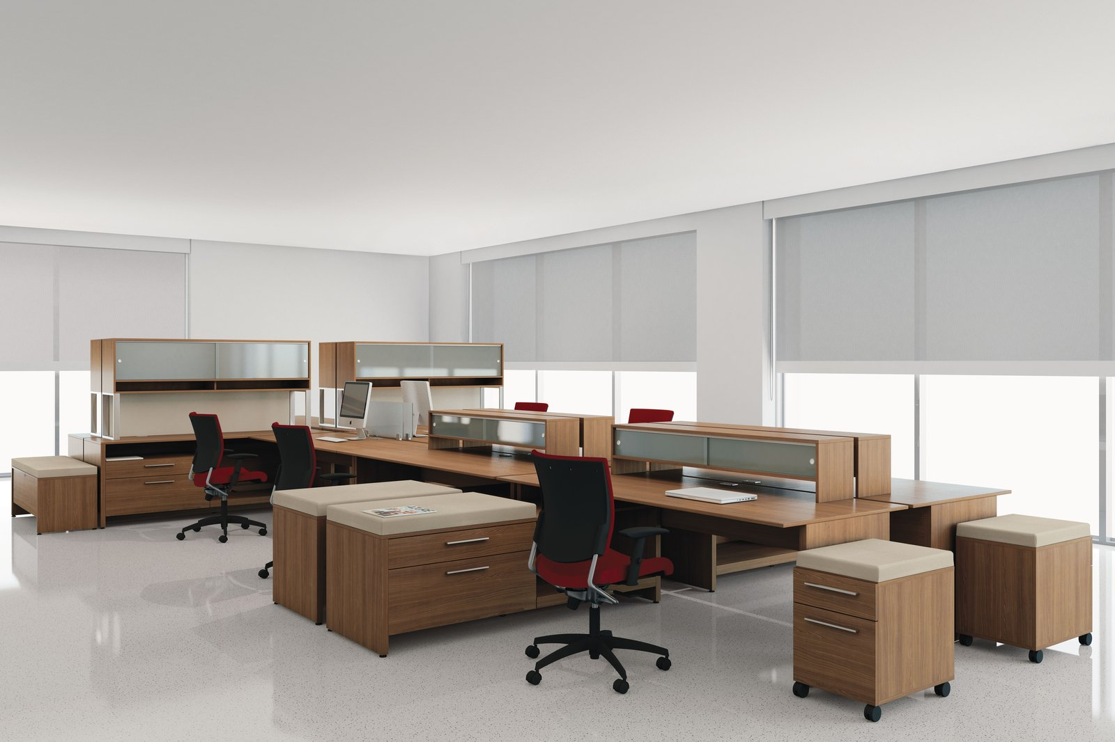 Studio photograph of a corner open-office, with side return credenzas. Seated at each is a red Graphic rolling chair, model 2739.