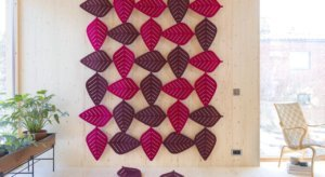 Studio shot of Airleaf acoustics along a wall, with 2 different shades of magenta.