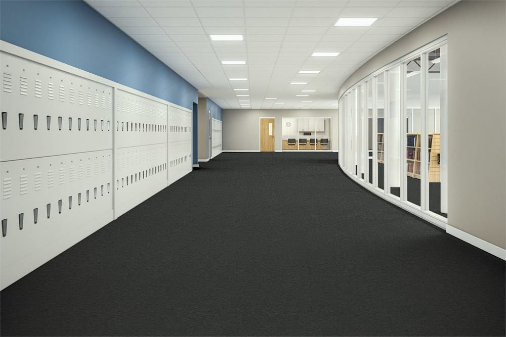 Passages 26 carpeted education corridor. Tall windows look into a library, just opposite of the lockers.