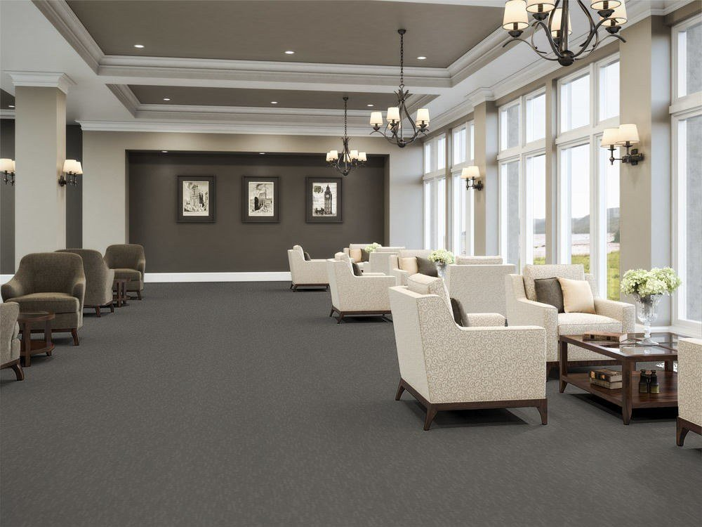 Tone flooring in a common area of the senior center. Tall windows on one side bring light in from outside.